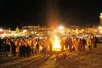 Crowds enjoying the annual bonfire in the evening of the Festival of Good Cheer