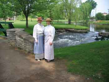 Two ladies in period dress, out for a stroll in Stewart Park during the Doors Open Event