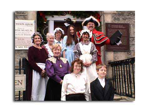 In Yesteryear - the Town Crier would be your guide to what was on in town and where everyone was.  This photo taken during the 2004 Festival of Good Cheer in November.  The Perth  Museum Staff and the  world champion Town Crier - Chris Wymann